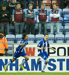 WIGAN, ENGLAND - Tuesday, March 16, 2010: Wigan Athletic's Gary Caldwell celebrates scoring the equalising goal against Aston Villa during the Premiership match at the DW Stadium. (Photo by David Rawcliffe/Propaganda)