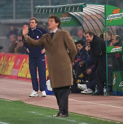 ROME, ITALY - Thursday, February 15, 2001: Liverpool's manager Gerard Houllier (right) and assistant Phil Thompson (left) watch as AS Roma's coach Fabio Cappello coahces his team from the touchline during the UEFA Cup 4th Round 1st Leg match at the Stadio Olimpico. (Pic by David Rawcliffe/Propaganda)