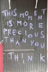 """Sign on a wall """"This Moment Is More Precious Than You Think"""""""