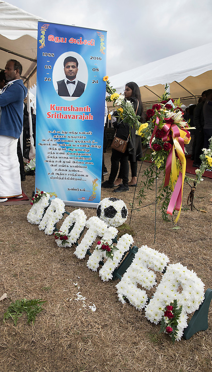 © Licensed to London News Pictures. 04/09/2016. London, UK. A floral tribute is placed outside a tent holding the coffin of Kurushanth Srithavarajah at a joint funeral held at Winn's Common Park for five men who drowned at Camber Sands last month.  The five men: Kurushanth Srithavarajah, brothers  Kenigan and Kobi Nathan, Inthushan Sri and Nitharsan Ravi were all friends from London.  They got into difficulty in the sea of Camber Sands on August 24. Photo credit: Peter Macdiarmid/LNP