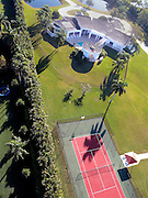 Aerial view of Home and tennis court in Southwest Ranches, Fl