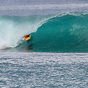 Surfer in perfect tube in Indonesia