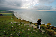Kiss 11. Part of a series of images produced by the photographer while travelling  as a working photo-journalist on the subject of 'love'.<br /> A couple embrace on the cliffs at Cap Blanc-Nez, Pas de Calais, France.