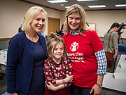 "24 MAY 2019 - WEST DES MOINES, IOWA: US Senator KIRSTEN GILLIBRAND (D-NY), left, talks to JEN STATLER, right, and her granddaughter, MYLAH STATLER, 7, after Gillibrand's forum on family rights in the West Des Moines Public Library. Gillibrand unveiled her ""Family Bill of Rights"" during a forum in West Des Moines. The New York Senator has made family health and rights a centerpiece of her campaign. She is touring Iowa this week to support her candidacy to be the Democratic nominee for the US Presidency. Iowa traditionally hosts the the first selection event of the presidential election cycle. The Iowa Caucuses will be on Feb. 3, 2020.           PHOTO BY JACK KURTZ"