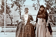 two smiling women dressed up in Moroccan traditional clothing 1930s
