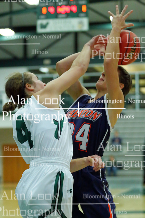 06 December 2017:  Maggie Dansdill has her shot blocked by Rebekah Ehresman during an NCAA women's basketball game between the Wheaton Thunder and the Illinois Wesleyan Titans in Shirk Center, Bloomington IL