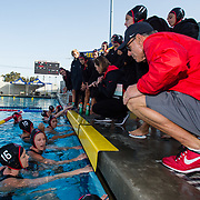 11 February 2018: The San Diego State  women's water polo team competes in day two of the Triton Invitation on the campus of UCSD. San Diego State assistant coach Bill Cohn and head coach Carin Crawford talk with their team prior to taking on CSUN. The Aztecs took on the #23 CSUN Matadors Sunday morning and came away with a 8-5 win.<br /> More game action at www.sdsuaztecphotos.com