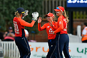 Wicket - Danielle Wyatt of England celebrates taking the catch to dismiss Sophie Devine of New Zealand off the bowling of Tash Farrant of England during the International T20 match between England Women Cricket and New Zealand at the Cooper Associates County Ground, Taunton, United Kingdom on 23 June 2018. Picture by Graham Hunt.