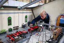 © Licensed to London News Pictures. 17/01/2020. London, UK. A member of the Harlington Locomotive Society tends to a model train at the London Model Engineering Exhibition at Alexandra Palace as<br /> enthusiasts and hobbyists visit the annual show in north London. Clubs and societies are exhibiting spectrum of modelling from traditional model engineering, steam locomotives and traction engines through to the more modern gadgets including trucks, boats, aeroplanes and helicopters with nearly 2,000 models constructed by their members. Photo credit: Dinendra Haria/LNP