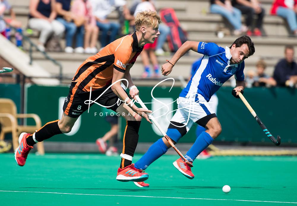 ROTTERDAM - Joep de Mol (Oranje-Rood) met Pepijn Luijkx (Kampong)  tijdens de wedstrijd om de derde plaats , Kampong- Oranje Rood , bij de ABN AMRO cup. COPYRIGHT KOEN SUYK