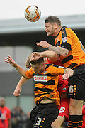 Barnet defender Micheal Nelson wins the header ahead of York City defender John McCoombe and Barnet defender Elliot Johnson during the Sky Bet League 2 match between Barnet and York City at Underhill Stadium, London, England on 17 October 2015. Photo by Simon Davies.