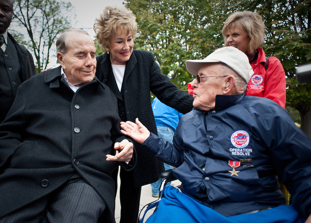 WASHINGTON, DC -- 11/3/12 - Edward Inkmann, 88, of West Ellis, leans in to chat with fellow veteran, Frmr. Sen. Bob Dole. In the background are Liddy Dole and Inkmann's daughter, Diane Hamilton...220 WWII veterans from southeastern Wisconsin go on a one day free trip to Washington, DC to see their memorials. The Stars and Stripes Honor Flight has taken 2237 veterans to see their memorials in DC since its inception.? by André Chung #AC1_2563