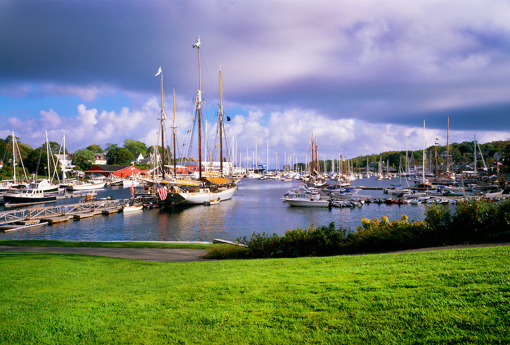 0905-1001B ~ Copyright: George H.H. Huey ~ Camden Harbor in summer with historic schooners [windjammers] at dock.  Knox County.  Maine.