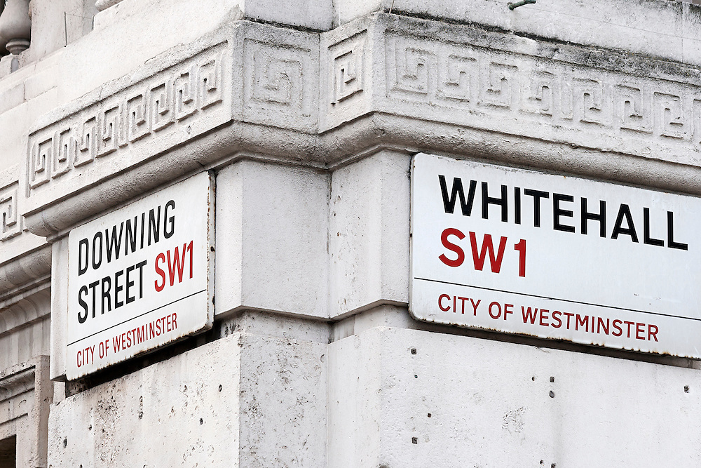 Signs on the corner of Whitehall and Downing Street, in the City of Westminster, London. This area is the home of British government, with the Prime Minister's official residence in Downing Street and various ministries in Whitehall.