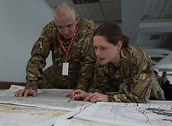 Image shows Sargeant Dave &quot;Dizzy&quot; Dawson, (left) Military Stabilisation &amp; Support Group, reviewing maps with another member of his unit as part of Exercise Civil Bridge in Bosnia &amp; Herzegovina. 09/03/2015.       <br /> <br /> Exercise Civil Bridge is an Overseas Training Exercise (OTX) conducted twice a year in support of UK Defence Engagement by elements of 77 Brigade. Civil Bridge 14B(CB 14B) is being conducted in Sarajevo, Bosnia and Herzegovina (BiH).  By assisting the BiH Government to develop their contingency plans for natural disasters at both strategic and operational levels, CB14B will contribute to the long term international effort to stabilise BiH ethinic groups and authorities.<br /> <br /> Credit should read: Cpl Mark Larner RY/MOD<br /> <br /> (c)MOD 2015