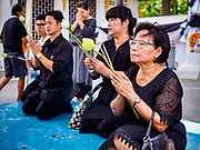 "11 APRIL 2017 - BANGKOK, THAILAND: People pray at Wat Chana Songkhram in Bangkok during a Songkran merit making service. Songkran is the traditional Thai Lunar New Year. It is celebrated, under different names, in Thailand, Myanmar, Laos, Cambodia and some parts of Vietnam and China. In most places the holiday is marked by water throwing and water fights and it is sometimes called the ""water festival."" This year's Songkran celebration in Thailand will be more subdued than usual because Thais are still mourning the October 2016 death of their revered Late King, Bhumibol Adulyadej. Songkran is officially a three day holiday, April 13-15, but is frequently celebrated for a full week. Thais start traveling back to their home provinces over the weekend; busses and trains going out of town have been packed.     PHOTO BY JACK KURTZ"