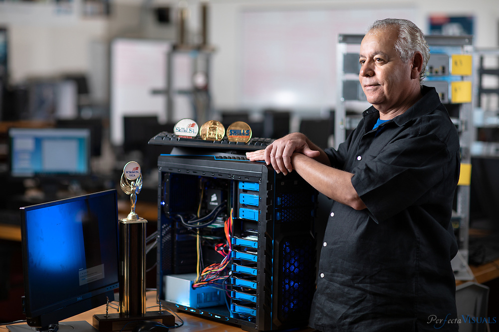 Reza Mohammadi consistently trains award winning students in his computer networking lab at Guilford County School's Weaver Academy. Photographed, Tuesday, May 8, 2018, in Greensboro, N.C. JERRY WOLFORD and SCOTT MUTHERSBAUGH / Perfecta Visuals<br /> <br /> <br /> <br /> During his 23 years of teaching at Weaver Academy, Reza Mohammadi often feels like a proud father.<br /> He&rsquo;s helped 10 of his students win national competitions in various categories of computer engineering technology, and he&rsquo;s taken more than 50 of his students from Guilford County to that same national stage.<br /> The competition is known as SkillsUSA Nationals, the Olympic trials for the country&rsquo;s top career and technical education students. To get there, students have to do well in North Carolina&rsquo;s SkillsUSA competition.<br /> But to even compete at the state level, they had to get the green light from Mohammadi. And Mohammadi is meticulous. <br /> He wants his students to be ready, and like some coach before a big game, he puts them through all sorts of exercises in his cavernous classroom full of computers.<br /> If they do well, Mohammadi knows what awaits his students. It could be a future where they can earn six-figure salaries and work for companies like Subaru and Lockheed-Martin.<br /> He&rsquo;s reminded of that future every time he walks into his classroom. It&rsquo;s right by the door. It&rsquo;s a bulletin board full of pictures and newspaper articles of his former students by the door. <br /> &ldquo;I&rsquo;ve accomplished something,&rdquo; he tells himself.<br /> He has -- more than his students really know.<br /> Mohammadi fled his home country of Iran 40 years ago to escape the political turmoil. He flew out on the last plane, he says, with only $500 in his pocket and a small bag that contained a few clothes and an American dictionary.<br /> Mohammadi was 18. He came to the United States by himself. He was a math whiz who couldn&rsquo;t speak a word of English. <br /> But he learned. <br /> He ended up earning a bachelor&rsquo;s degree in electrical engineering from West Virginia University and