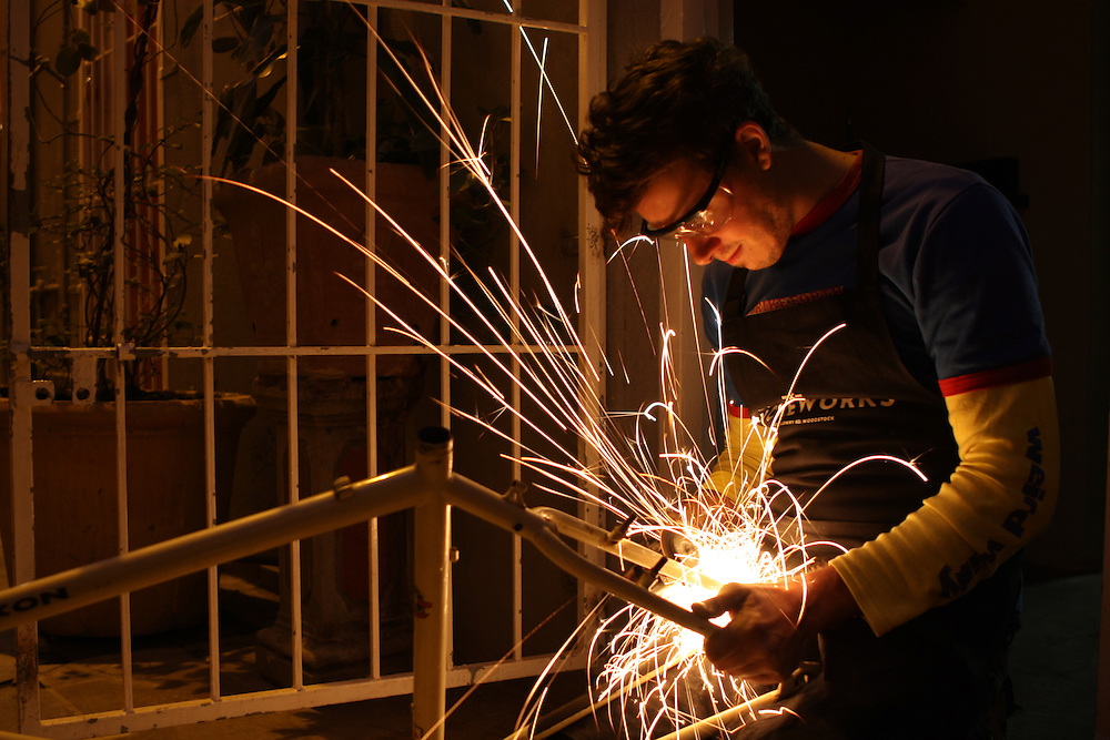 Working away on another custom creation, sparks fly as Nils grinds away extra metal.