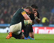 New Zealand hooker Keven Mealamu is exhausted and South Africa number eight Duane Vermeulen is dejected after the final whistle of the Rugby World Cup Semi-Final match between South Africa and New Zealand at Twickenham, Richmond, United Kingdom on 24 October 2015. Photo by David Charbit.