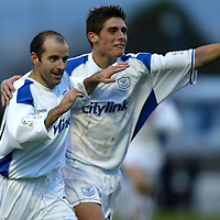 Queen of the South v St Johnstone..1.11.03<br />Brian McLaughlin celebrates his goal with Ross Forsyth<br /><br />Picture by Graeme Hart.<br />Copyright Perthshire Picture Agency<br />Tel: 01738 623350  Mobile: 07990 594431