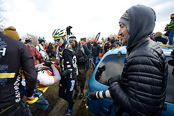 Annual Bilenky Junkyard Cyclocross & SSCXWC '13 Qualifier rounds - North Philadelphia, PA USA - December 7, 2013; Lee Rogers (right), owner of Philadelphia bike shop Bicycle Therapy, watches as an unnamed rider is transported away from the scene on a stretcher after crashing his bike
