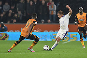 Marc Albrighton of Leicester City kicks forward past Hull City midfielder Moses Odubajo during the Capital One Cup Fourth Round match between Hull City and Leicester City at the KC Stadium, Kingston upon Hull, England on 27 October 2015. Photo by Ian Lyall.