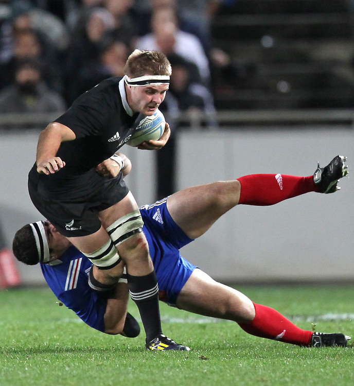 France's Guilhem Guirado challenges New Zealand's Sam Cane in the 1st International rugby test match, Eden Park, Auckland, New Zealand, Saturday, June 08, 2013.  Credit:SNPA / David Rowland