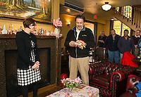 Laconia Planning Director Shanna Saunders is thanked by Mayor Ed Engler for her service to the City of Laconia and presented with a gift brick that will be inscribed with her name and placed in the WOW Trail Park during a gathering in her honor at the Holy Grail on Tuesday evening.  (Karen Bobotas/for the Laconia Daily Sun)
