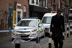 © Licensed to London News Pictures. 12/04/2017. Manchester, UK . Police close off Spear Street behind Piccadilly , in Central Manchester this morning , after a man in his 20s was found dead in a doorway there at approximately 01:40 this morning . Paramedics attended but pronounced the man dead at the scene . Police were then called to attend . Photo credit: Joel Goodman/LNP