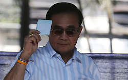 March 24, 2019 - Bangkok, Thailand - Thailand's Prime Minister Prayut Chan-o-cha drops his vote into a ballot box during Thailand election at a polling station in Bangkok. (Credit Image: © Chaiwat Subprasom/SOPA Images via ZUMA Wire)