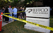 Caution tape is wrapped around the sign outside the site of a Jefferson County school board meeting in Golden, Colorado October 2, 2014. Protestors from opposing sides were making their views known on proposed changes to a history curriculum that would stress patriotism and discourage civil disobedience. The question of how U.S. teens learn history in public schools is the latest flash point in a liberal-conservative fight over national curricula that had previously focused on more scientific topics such as teaching creationism versus evolution.  REUTERS/Rick Wilking (UNITED STATES)