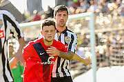 Notts County defender Alan Sheehan has a hold of York City forward Reece Thompson during the Sky Bet League 2 match between Notts County and York City at Meadow Lane, Nottingham, England on 26 September 2015. Photo by Simon Davies.