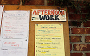 A daily work schedule is posted in the dining hall at the Mountain School
