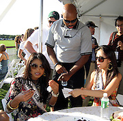 Security at the Polo telling Miss USA, Rachael Smith with Miss Universe Riyo Mori how they don't have a green bracelet so they cannot be inside the VIP tent, he asks them to leave..Mercedes-Benz Challenge Cup.Bridgehampton Polo.Bridgehampton Polo Club, Hayground Road, Water Mill, NY, USA.Saturday, August 18, 2007.Photo By Celebrityvibe.com.To license this image please call (212) 410. 5354; or.Email: celebrityvibe@gmail.com ;.