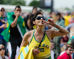 © Licensed to London News Pictures. 11/08/2012. London, UK.  Brazilian football fans watch the Olympic final featuring Brazil vs Mexico being played on big screens at BT London Live 2012, Hyde Park.   Photo credit : Richard Isaac/LNP