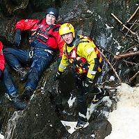 Tayside Fire & Rescue Water Rescue Exercise, The Hermitage, Dunkeld, Perthshire...04.05.10<br /> Record reporter James Moncur in the raging waters of the River Braan at The Hermitage with Nici D'Arcy and Mike Assenti from Tayside Police Search & Rescue, Mike was acting as the casualty.<br /> Picture by Graeme Hart.<br /> Copyright Perthshire Picture Agency<br /> Tel: 01738 623350  Mobile: 07990 594431