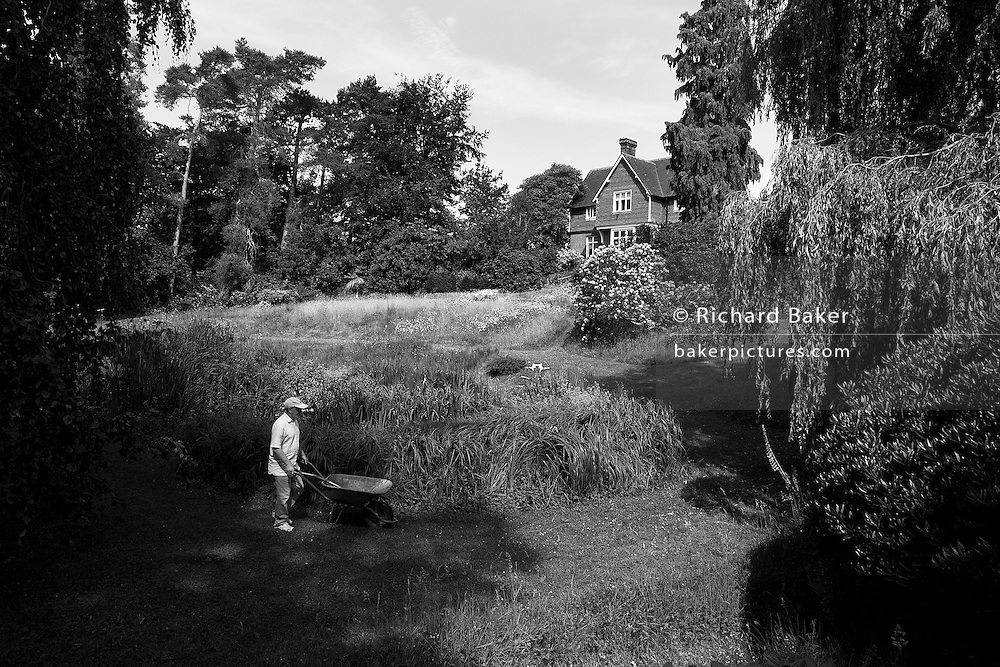 Volunteer Buddhist on working retreat at the Rivendell Buddhist Retreat Centre, East Sussex, England. ...Reproduced for Alain de Botton's 'Religion for Atheists' 2010. .Photograph copyright Richard Baker, London.richard@bakerpictures.com.Tel 0044 207836 287080.