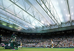 LONDON, ENGLAND - Tuesday, June 28, 2011: Marion Bartoli (FRA) takes on Sabine Lisicki (GER) during the Ladies' Singles Quarter-Final match on day eight of the Wimbledon Lawn Tennis Championships at the All England Lawn Tennis and Croquet Club. (Pic by David Rawcliffe/Propaganda)
