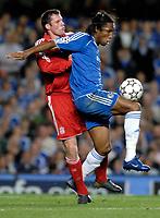 Photo: Richard Lane.<br />Chelsea v Liverpool. UEFA Champions League. Semi Final, 1st Leg. 25/04/2007. <br />Liverpool's Jamie Carragher challenges Chelsea's Didier Drogba.