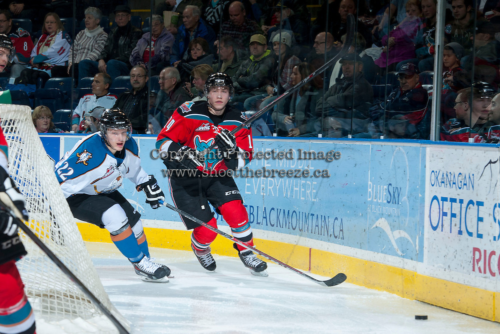 KELOWNA, CANADA - DECEMBER 7: Rourke Chartier #14 of the Kelowna Rockets makes a pass against the Kootenay Ice on December 7, 2013 at Prospera Place in Kelowna, British Columbia, Canada.   (Photo by Marissa Baecker/Shoot the Breeze)  ***  Local Caption  ***