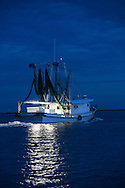 Shrimpboat in Point au Chien, Louisiana. Point au Chien is subject to coastal erosion. The area is inhabited by members of the Point-aux-Chien indian tribe and fishermen.