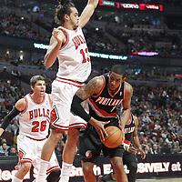 16 March 2012: Chicago Bulls center Joakim Noah (13) defends on Portland Trail Blazers power forward LaMarcus Aldridge (12) during the Portland Trail Blazers 100-89 victory over the Chicago Bulls at the United Center, Chicago, Illinois, USA.