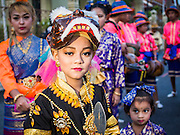 30 OCTOBER 2014 - BANGKOK, THAILAND: Traditional dancers get ready to perform in the parade marking the start of the annual temple fair at Wat Saket. Wat Saket is on a man-made hill in the historic section of Bangkok. The temple has golden spire that is 260 feet high which was the highest point in Bangkok for more than 100 years. The temple construction began in the 1800s in the reign of King Rama III and was completed in the reign of King Rama IV. The annual temple fair is held on the 12th lunar month, for nine days around the November full moon. During the fair a red cloth (reminiscent of a monk's robe) is placed around the Golden Mount while the temple grounds hosts Thai traditional theatre, food stalls and traditional shows.   PHOTO BY JACK KURTZ