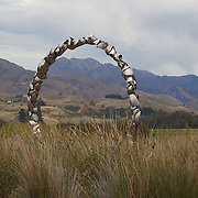 A metal sculpture in front of the modern cellar door at Spy Valley Winery, Lake Timara Road West. Marlborough. New Zealand. ..The Marlborough wine region is New Zealand's largest wine producer. The Marlborough wine region has earned a global reputation for viticultural excellence since the 1970s. It has an enviable international reputation for producing the best Sauvignon Blanc in the world. It also makes very good Chardonnay and Riesling and is fast developing a reputation for high quality Pinot Noir. Of the region's ten thousand hectares of grapes (almost half the national crop) one third are planted in Sauvignon Blanc. Marlborough, New Zealand, 12th February 2011. Photo Tim Clayton