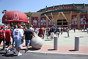 ANAHEIM, CA - JUNE 16:  Fans enter the stadium past a large metal cap and concrete baseball outside the stadium before the Los Angeles Angels of Anaheim game against the New York Yankees on Sunday, June 16, 2013 at Angel Stadium in Anaheim, California. The Yankees won the game 6-5. (Photo by Paul Spinelli/MLB Photos via Getty Images)