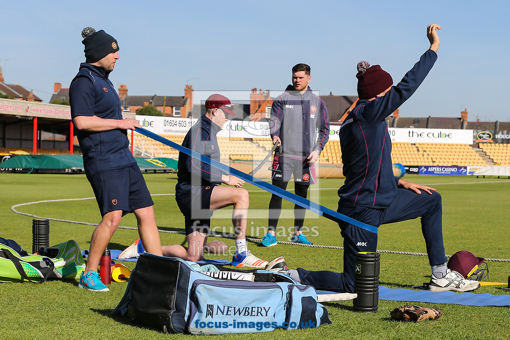 The Northants CCC strength and conditioning team take the players through their paces during the warm up before day two of the Friendly match at the County Ground, Northampton<br /> Picture by Andy Kearns/Focus Images Ltd 0781 864 4264<br /> 03/04/2017