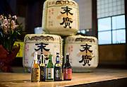 Photo shows Suehiro Sake Brewery in Aizu-wakamatsu City, Fukushima, Japan on 15 March 2013.  Photographer: Robert GilhoolyPhoto shows some of the high-grade sake products at the Suehiro Sake Brewery in Aizu-wakamatsu City, Fukushima, Japan on 15 March 2013.  From left to right is an oak-aged sake, Ken, which is popular with overseas consumers, Yamahai, which won the 2007 International Wine Challenge in London, Gensai, said the be the sake of choice of Japan's emperor and Kiri, an extra-dry sake. Photographer: Robert Gilhooly