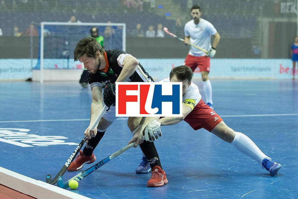 Hockey, Seizoen 2017-2018, 08-02-2018, Berlijn,  Max-Schmelling Halle, WK Zaalhockey 2018 MEN, Poland - Germany 3-6, ZWICKER Martin (GER) and ZYWICZKA Bartosz (C) (POL).