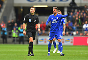 Referee Craig Pawson and Victor Camarasa (21) of Cardiff City during the Premier League match between Cardiff City and Chelsea at the Cardiff City Stadium, Cardiff, Wales on 31 March 2019.