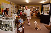 "Gary Malagari, Scott Grant and ""Tanner"" are ready to welcome customers at Paws Antiques in Meredith. (Karen Bobotas/for the Laconia Daily Sun)"